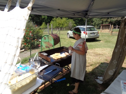 Gail Hobbs Page, cheesemaker and owner cooking our grilled cheese paninis