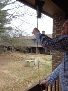 Measuring the feeder from the railing