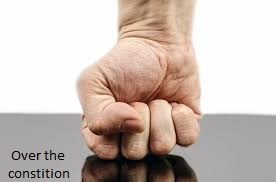 hands pushing down the constituion