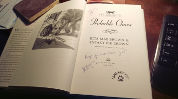 Rita Mae Brown autographs my book