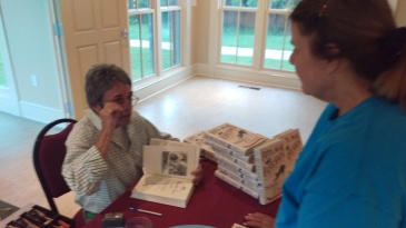 Rita Mae Brown signing one of my books at Tabor Presbyterian Church in Crozet 20180718
