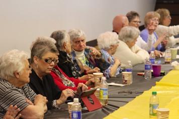 senior citizens at table.