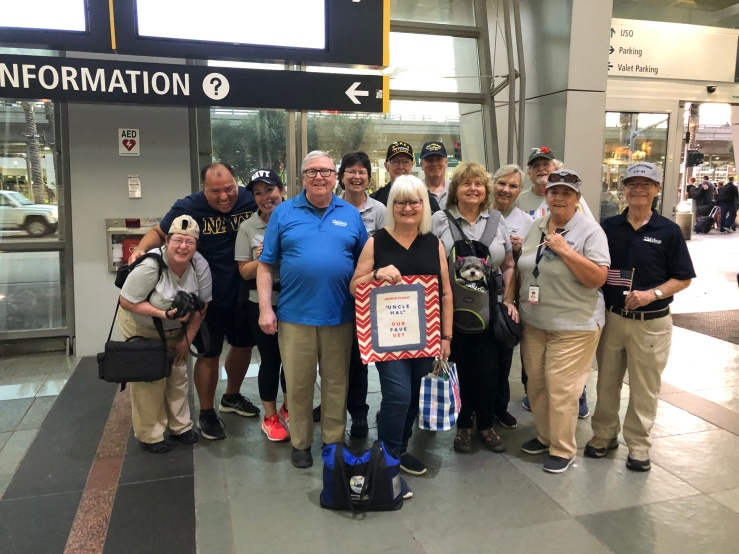Midway staff waiting to greet Hal when he returned from his Honor Flight.jpg