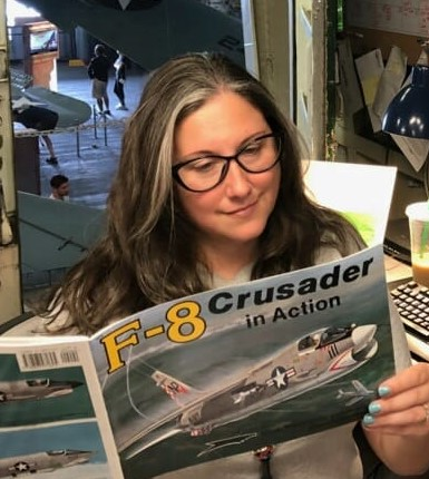 Angela reading the F-8 book.