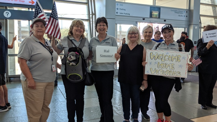 Hallettes waiting to welcome Hall a the San Diego airport upon his return from Washington, DC 6 Oct 2019