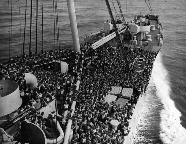 Troops performing a lifeboat drill on board the Queen Mary in December 1944 before Magic Carpet Ride.