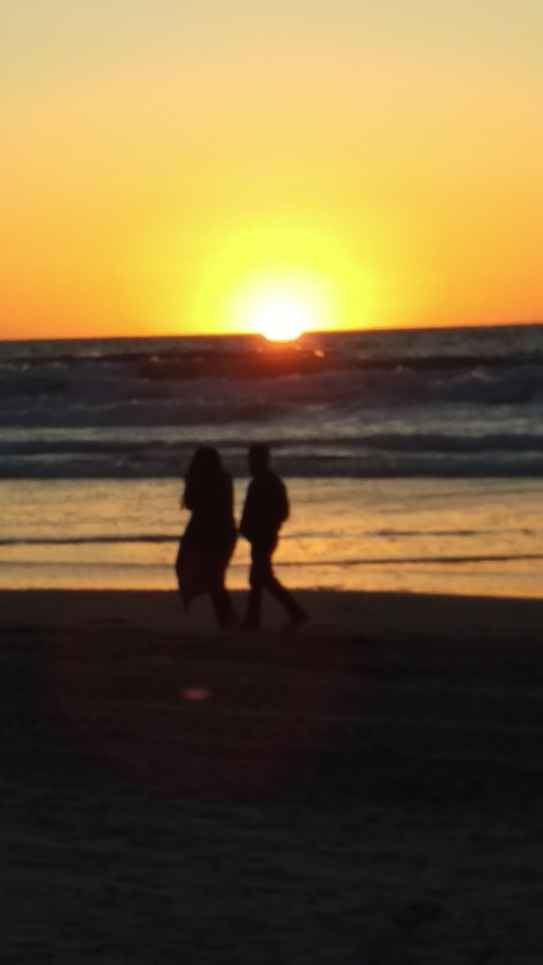 two walking at sunset